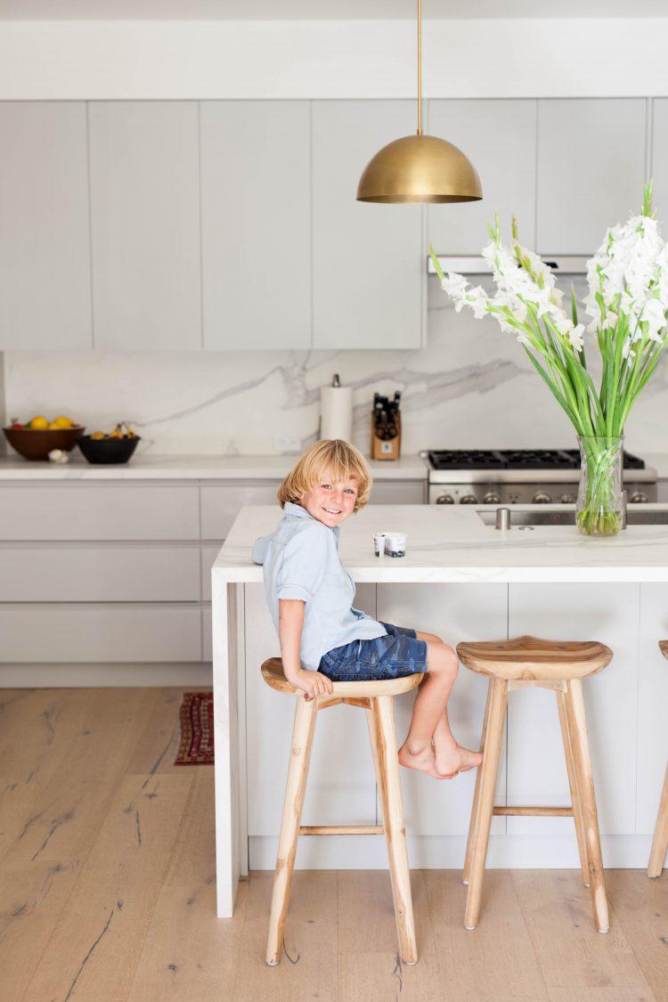 boy in a modern white kitchen