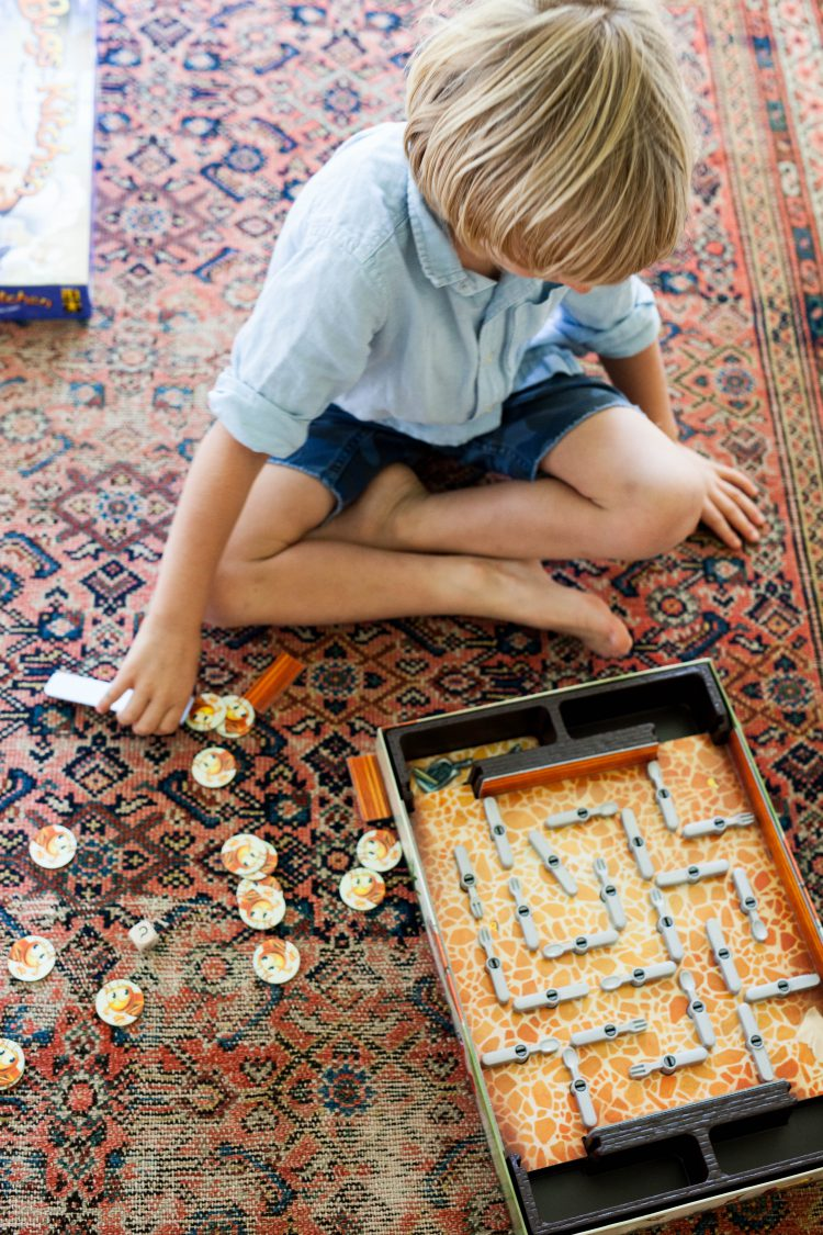 boy playing game on the floor