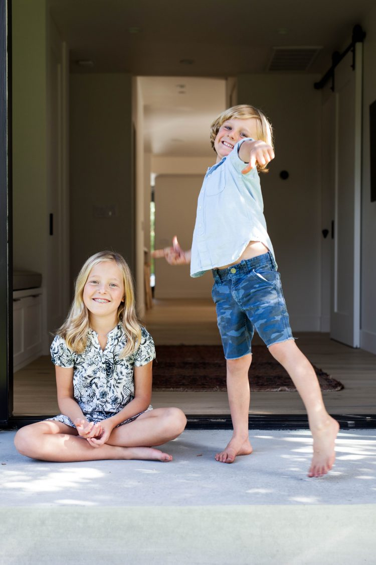 happy kids outside modern house