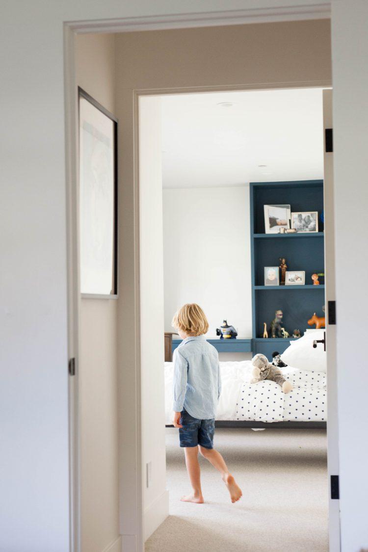 boy walking in modern home