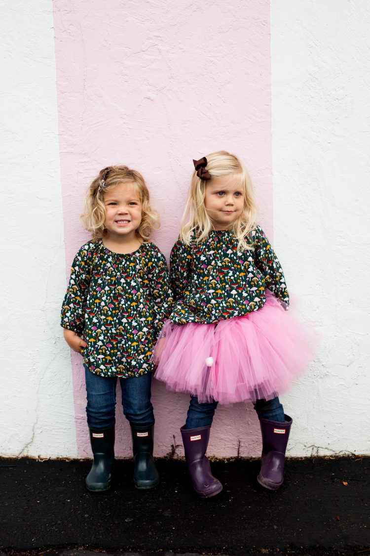 Twins in boots and pink tutu