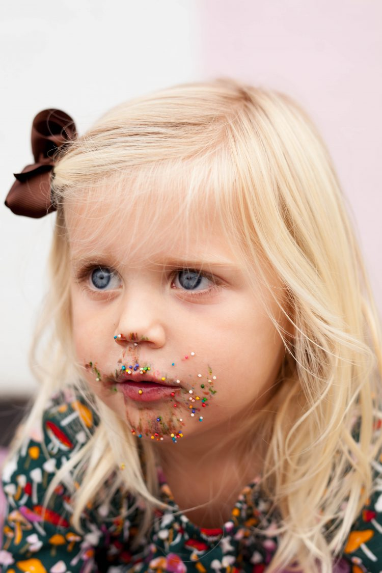girl with sprinkles on her face