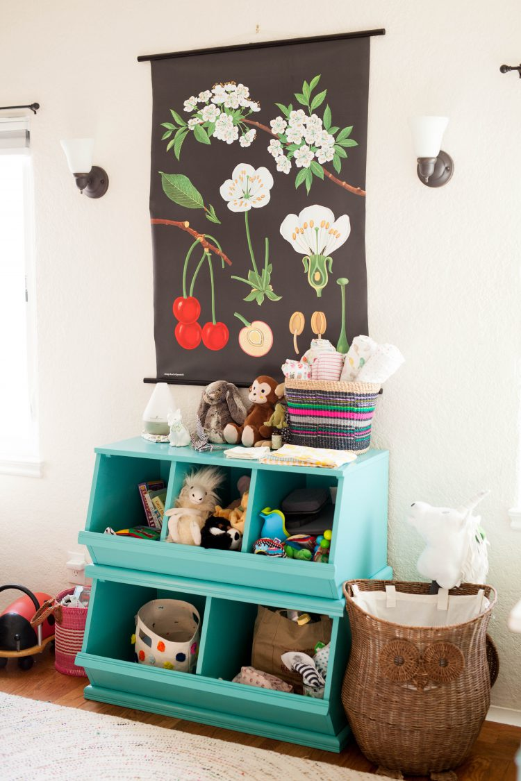 aqua green toy storage and floral wall art