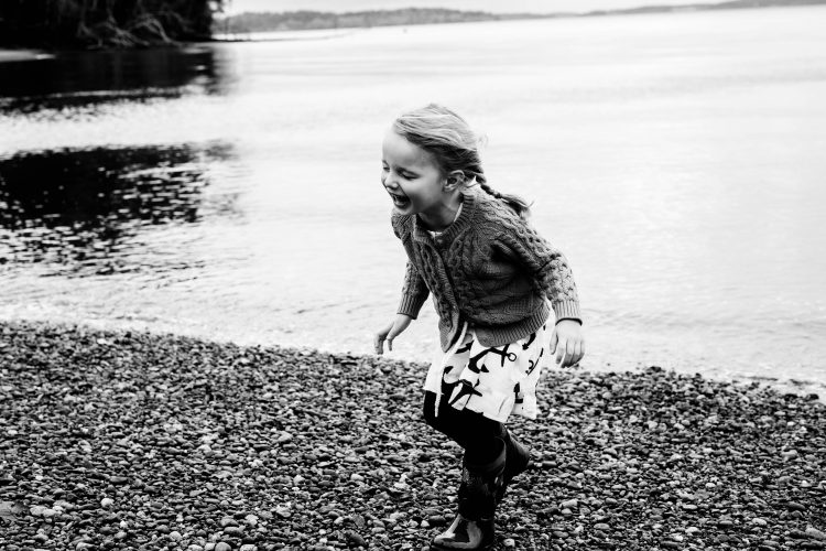 girl laughing on the beach in Olympia
