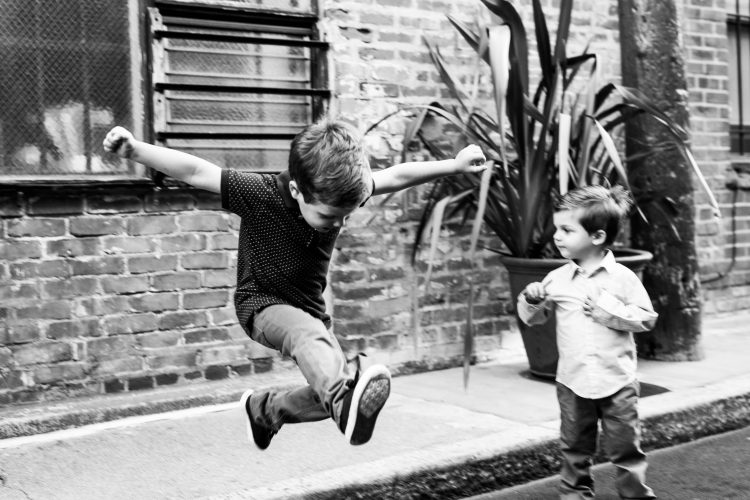 boys playing and jumping