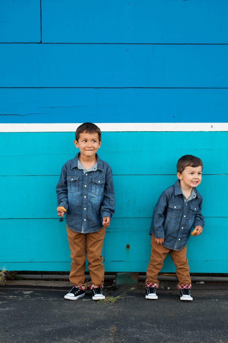 boys in matching denim outfits