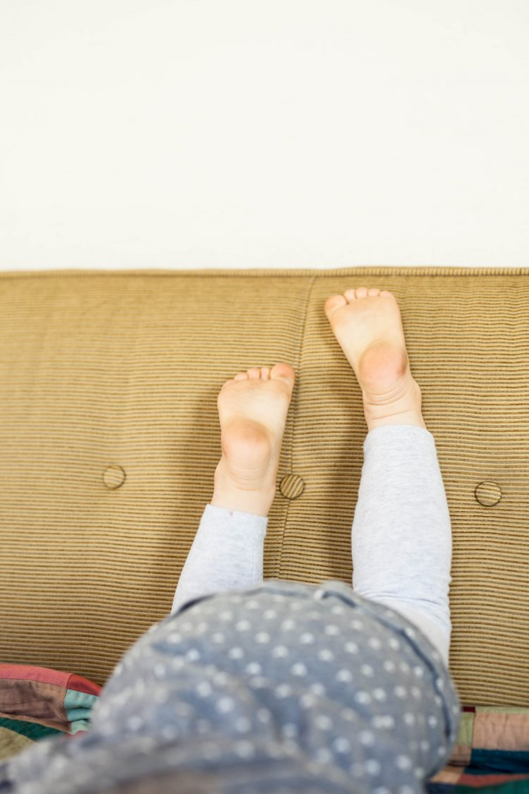kid's feet on sofa