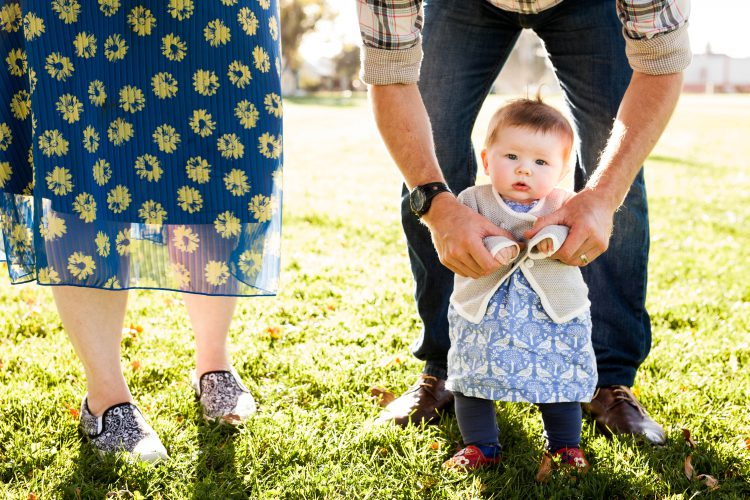 baby and parents in the grass