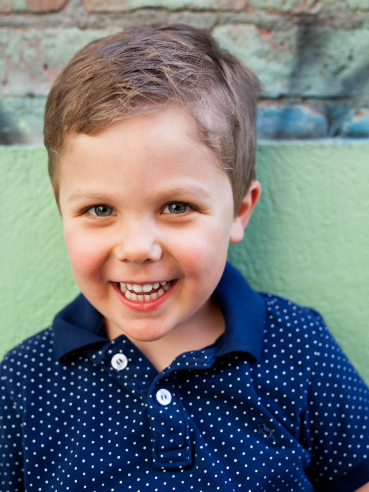 smiling boy in blue shirt