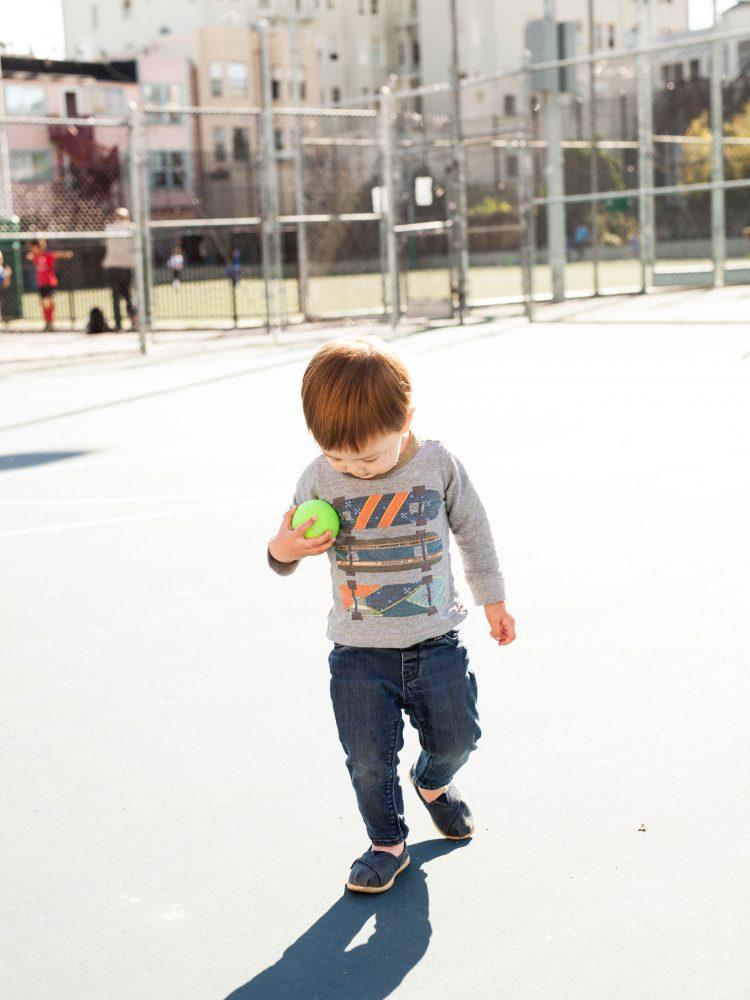boy holding tennis ball